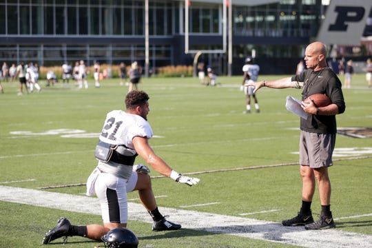 Purdue assistant coach Nick Holt talks with Purdue linebacker Markus Bailey (21) during practice, Saturday, Aug. 3, 2019 at Bimel Practice Complex in West Lafayette.