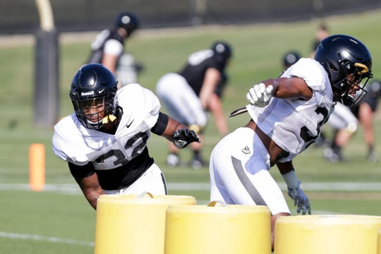 Purdue defensive back Elijah Ball (32) and Purdue linebacker Jaylan Alexander (36) run through a drill during practice, Saturday, Aug. 3, 2019 at Bimel Practice Complex in West Lafayette.