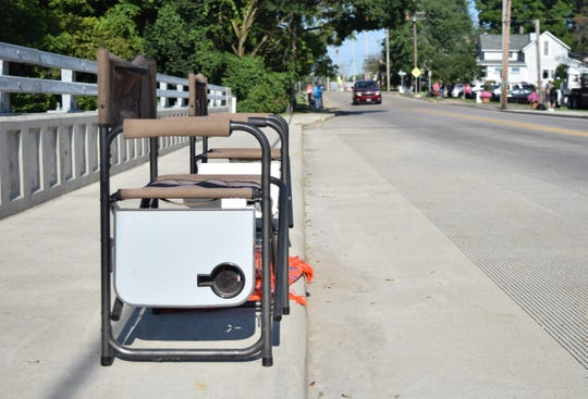 Chairs sit empty, saving space along the  route Saturday for the Baltimore Festival Parade.