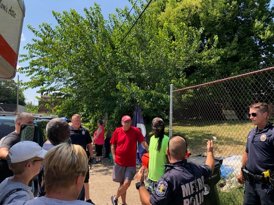 Around noon Saturday, Louisville Metro Police officers informed 11 residents of a makeshift camp between Brook and Floyd streets that a new property owner wanted them out by 3 p.m.