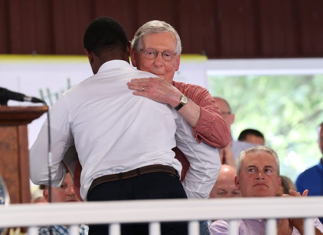Daniel Cameron, a candidate for Kentucky attorney general, embraced Sen. Mitch McConnell, right, following his speech during the Fancy Farm political picnic in Fancy Farm, Ky. Aug. 3, 2019