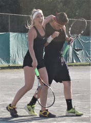 Shellie and Nickie Wong, the only husband-wife tandem in the field, won mixed doubles Friday night in the 86th News Journal/Richland Bank Tennis Tournament at Lakewood Racquet Club.