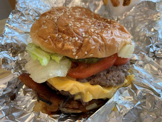 A bacon cheeseburger from Five Guys, Lely.