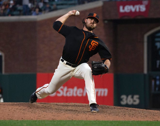 Jul 28, 2018; San Francisco, CA, USA; San Francisco Giants pitcher Ray Black (62) delivers against the Milwaukee Brewers in the eighth inning of a Major League Baseball game at AT&T Park. Mandatory Credit: D. Ross Cameron-USA TODAY Sports