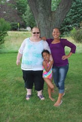 Sheila Eagle, 54; Tamara Lynn Eagle, 29; and Nyobee Eagle Richardson, 11, are seen in this photo provided by a family friend. All three died early Friday in a wrong-way crash in Minnesota.