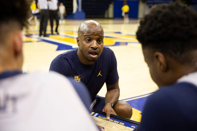 Marquette assistant coach Dwayne Killings talks to the players during a break.