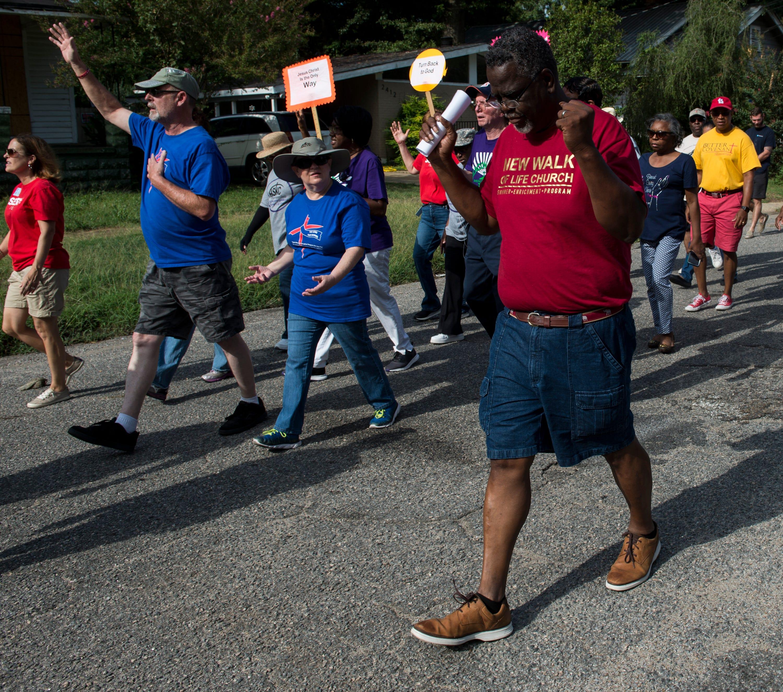 Pastor Ken Austin during a Prayer Walk in the Highland Park neighborhood in Montgomery, Ala., on Saturday, Aug. 3, 2019.