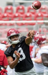 Alabama quarterback Tua Tagovailoa (13) during Alabama's fan day practice at Bryant-Denny Stadium on the UA campus in Tuscaloosa, Ala., on Saturday August 3, 2019.