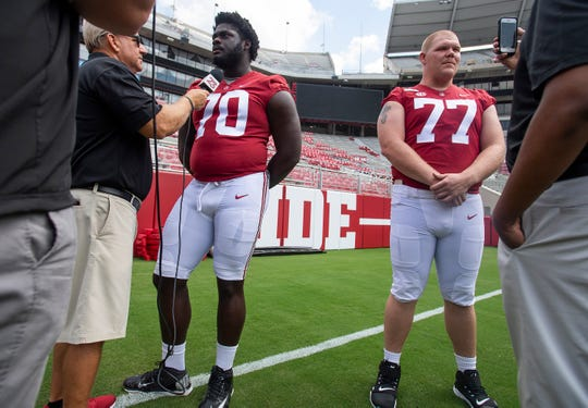 Alabama offensive linemen Alex Leatherwood (70) and  Matt Womack (77) talk with reporters during a media availability at Bryant-Denny Stadium on the UA campus in Tuscaloosa, Ala., on Saturday August 3, 2019.
