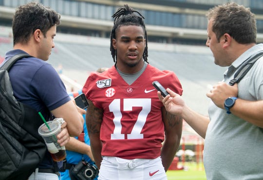 Alabama wide receiver Jaylen Waddle (17) talks with reporters during a media availability at Bryant-Denny Stadium on the UA campus in Tuscaloosa, Ala., on Saturday August 3, 2019.