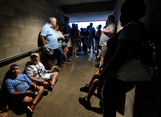 Titans fans wait out a weather delay before practice at Nissan Stadium Saturday, Aug. 3, 2019, in Nashville, Tenn.