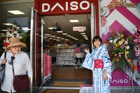 Daiso, a store similar to a dollar store, opens in Edgewater on Saturday August 3, 2019. Sasaki Midori welcomes shoppers in a kimono.
