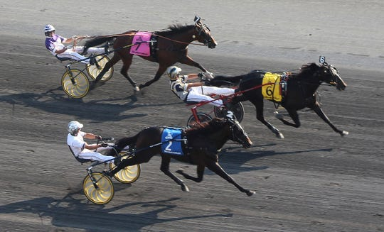 Driver Bob McClure guides No. 6 Forbidden Trade to a neck-length victory over  No. 2 Greenshoe and driver Brian Sears in the $1 million Hambletonian at The Meadowlands Saturday, Aug. 3, 2019. Dave Miller and No. 7 Gimpanzee finish third in trotting's biggest race.