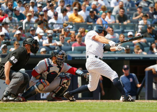 Aug 3, 2019; Bronx, NY, USA; New York Yankees center fielder Brett Gardner (11) hits a two run single against the Boston Red Sox during the fourth inning of game one of a doubleheader at Yankees Stadium.