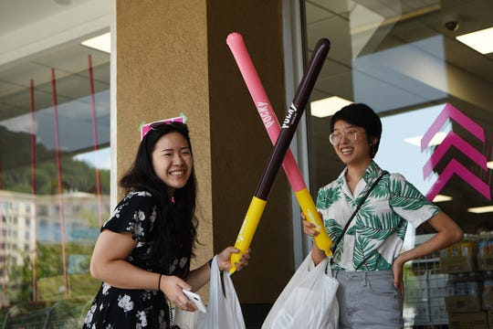 Daiso, a store similar to a dollar store, opens in Edgewater on Saturday August 3, 2019. Amy Ho from Bridgeater and Sabrina Ko from River Edge have a sword fight with their Pocky balloons.