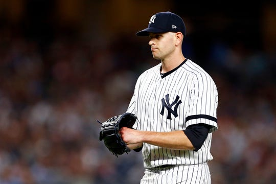 New York Yankees pitcher James Paxton (65) reacts against the Boston Red Sox during the fourth inning at Yankee Stadium.