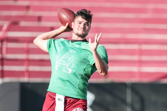 Quarterback Josh Adkins runs drills at New Mexico State University's first practice of the year in Aggie Memorial Stadium on Friday, Aug 2, 2019.