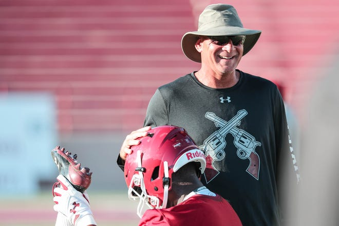 Head coach Doug Martin runs drills at New Mexico State University's first practice of the year in Aggie Memorial Stadium on Friday, Aug 2, 2019.