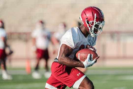 Running back Christian Gibson runs drills at New Mexico State University's first practice of the year in Aggie Memorial Stadium on Friday, Aug 2, 2019.