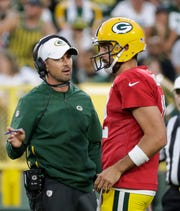 Head coach Matt LaFleur talks to quarterback Aaron Rodgers (12) during Packers family night Friday, August 2, 2019, at Lambeau Field in Green Bay, Wis.