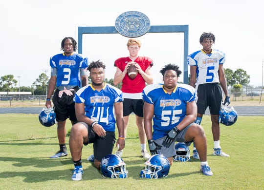 From left, football defensive end Eric Thomas (3), defensive end Amari Severson (44), quarterback Robert Sherlock, defensive tackle Malcolm Moultrie (55), and receiver Erick Smith (5) at Booker T. Washington High School in Pensacola on Thursday, August 1, 2019.