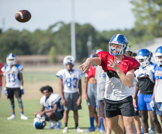 Quarterback Robert Sherlock passes the ball during football practice at Booker T. Washington High School in Pensacola on Thursday, August 1, 2019.
