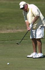 Jerry Stephens putts on the first green on his way to playing 75 holes of golf on his 75th birthday in 2008. Stephens passed away earlier this week.