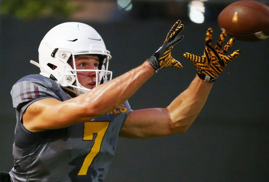 Arizona State quarterback Ethan Long (7) catches a pass during football practice on Aug. 2, 2019 in Tempe, Ariz.