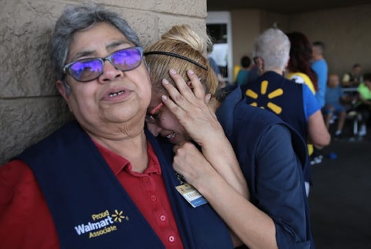 Walmart employees react after an active shooter opened fire at the store at Cielo Vista Mall in El Paso, Tx. on Saturday, on Aug. 3, 2019.