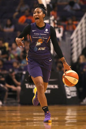 Mercury guard Briann January takes the ball down the court against the Dallas Wings in the first half at Talking Stick Resort Arena on July 17, 2019 in Phoenix, Ariz.