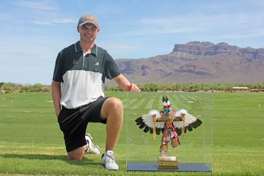 Evan White poses with the Arizona Amateur championship trophy.