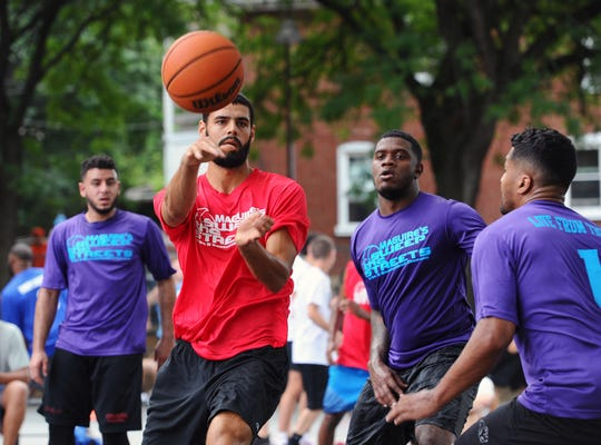 Lebanon High grad Blayde Reich of defending champ Fuhrman Industrial makes a pass during Sweep The Streets Day 1 action on Saturday at Southeast Playground.