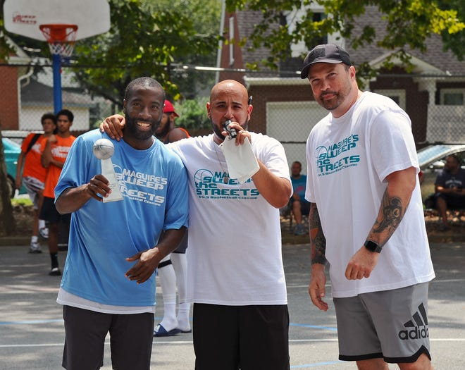 Arthur Johnson, left, receives the Community Hero award from Sweep The Streets organizers George Rodriguez and  Robert Cleapor at  last year's tournament.