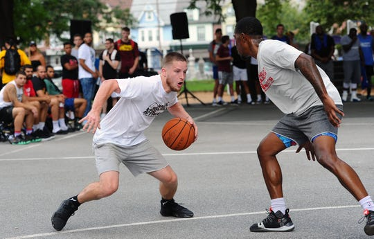 Northern Lebanon and LVC alum SAm Light makes a move to the basket on Saturday during the first day of the 12th annual Sweep The Streets tournament at Southeast Playground.
