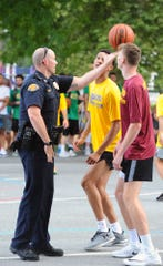 The Lebanon City Police Department took part in the opening tip-off at the 12th annual Sweep The Streets tournament at Southeast Playground on Saturday.