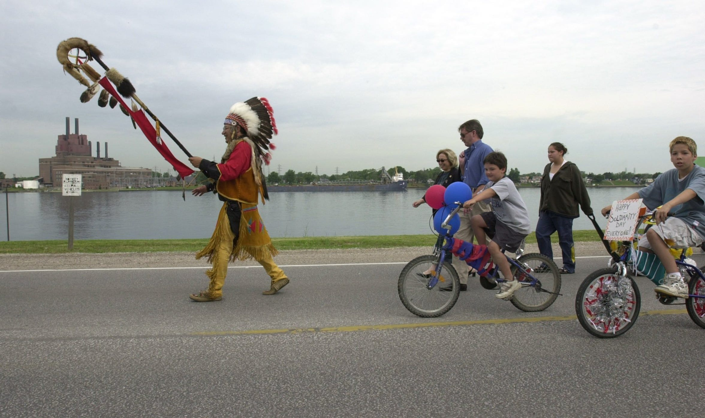 Walking along the St. Clair River in Sarnia, then-tribal Chief Phil Maness of the Sarnia Aamjiwnaang First Nation, also called the Sarnia Chippewa tribe, leads a parade during the 40th annual powwow in June 2001.
