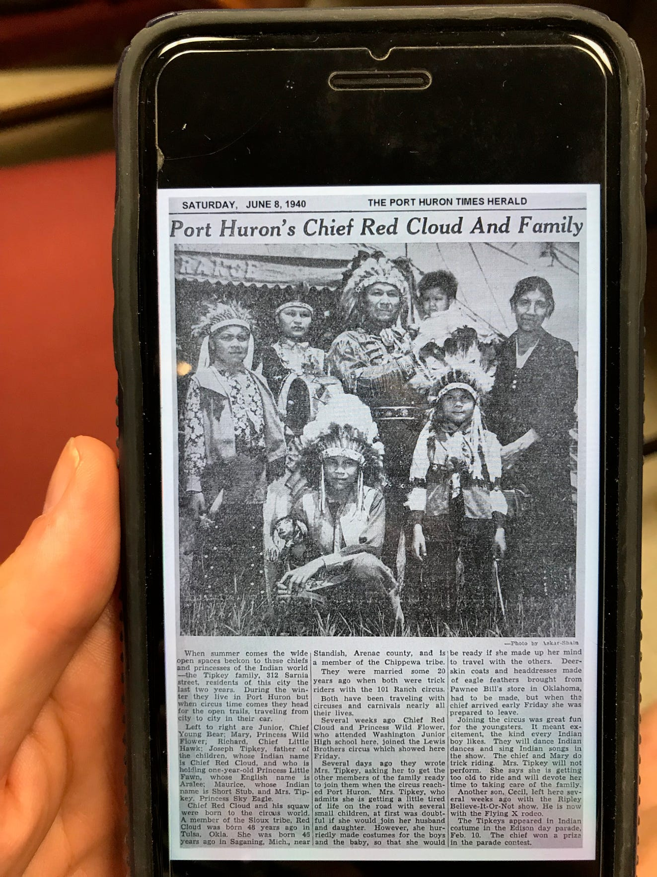 Joan Tipkey Jacobs shows an image of a 1940 Times Herald article about her family on her phone following a meeting at the Port Huron Museum on Thursday, Aug. 1, 2019. She said she'd relatives who were teachers that shared their heritage, adding she and her husband try to do something similar.