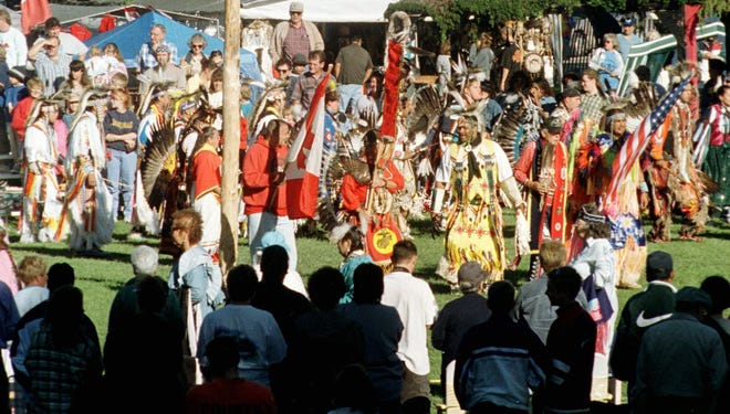 Native Americans of several nations dance during the Grand Entry at the fifth annual Blue Water Indian Celebration, or PowWow at Pine Grove Park, in 1999.