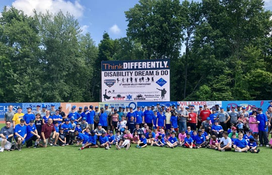 The Hudson Valley Renegades pose with more than 100 participants at the Disability, Dream & Do baseball camp Saturday at Dutchess Stadium.
