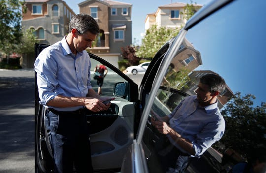 "Democratic presidential candidate and former Texas Congressman Beto O'Rourke looks at his phone before driving away after a Service Employees International Union ""Walk A Day In the Shoes"" event, Thursday, Aug. 1, 2019, in Las Vegas."