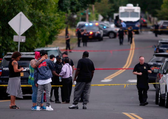Portland police respond to a fatal shooting in Northeast Portland, Ore., on Friday, Aug. 2, 2019. The Portland Police Bureau says officers responding to a shooting report just after 2 p.m. Friday found multiple victims injured. (Beth Nakamura/The Oregonian via AP)