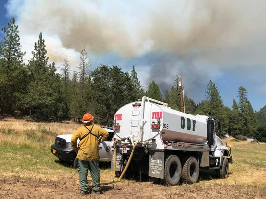 Views of the East Evans Creek Road Fire in Southern Oregon on Friday.
