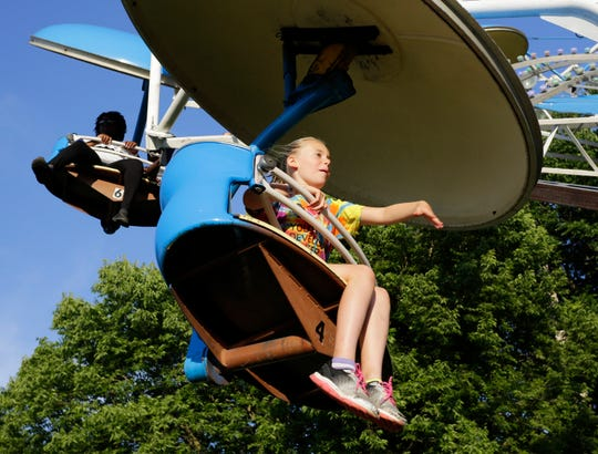 Khloe McKnight, 9, of Sheboygan. rides a carnival ride during opening day of Brat Days, Friday, August 2, 2019, Kiwanis Park, in Sheboygan, Wis.