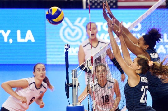 U.S. women's volleyball's Kelsey Robinson and Haleigh Washington, right, during their game against Kazakhstan Friday, August 2, 2019, at the CenturyLink Center in Bossier City in the first of three matches trying to qualify for the Tokyo Olympic Games.