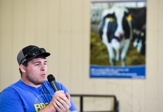 "Blake Wolters does his best cow impersonation during the ""mooing"" contest at the Sioux Empire Fair, Saturday, Aug. 3."