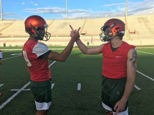 FAMU kicker Yahia Aly (left) and long snapper Christian Mastramico celebrate with their unique handshake.