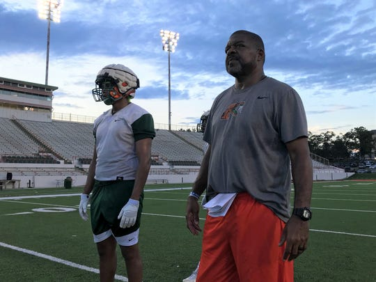 FAMU associate head coach/tight ends coach James Spady looks over the offense with tight end Kieran Goodrich.