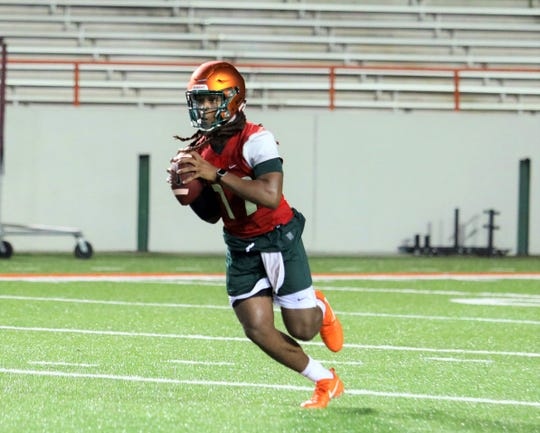 FAMU backup quarterback RaSean McKay rolls out for a pass during practice on Friday, Aug. 2, 2019.