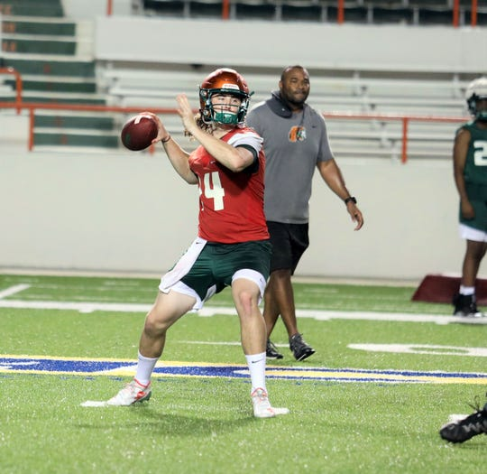 FAMU quarterback Ryan Stanley drops back to pass during the first day of practice on Friday, Aug. 2, 2019.