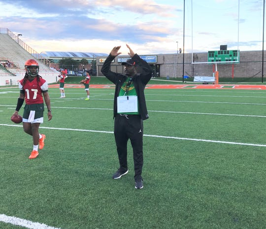 FAMU football head coach Willie Simmons calls out plays for the offense during the opening practice for the Rattlers.